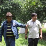 Celso Evangelista and Dr.Orville Bondoc looking at the locally-bred show stags at LS Game farm,Sept 11/2010.